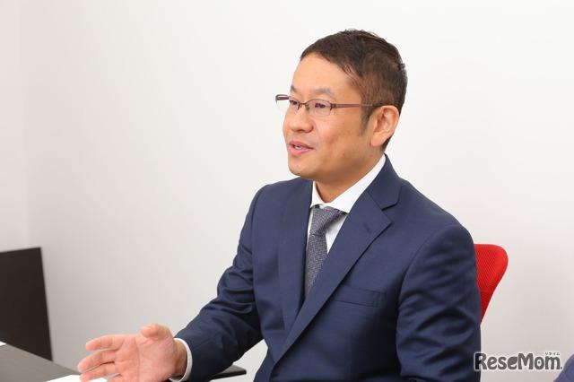 インタビューに応じる小川大介氏
