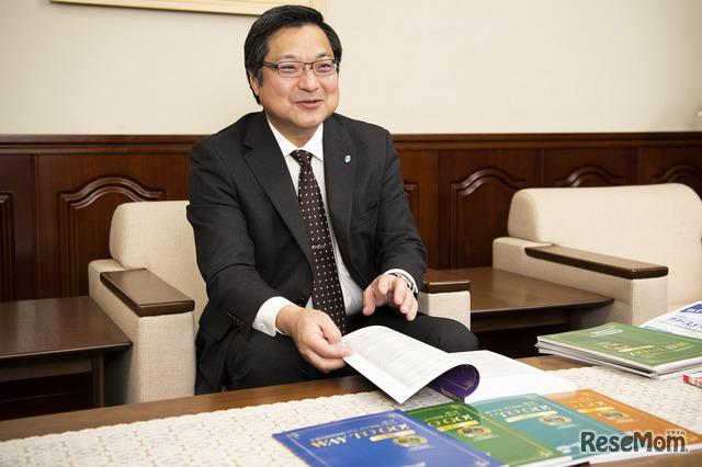 資料について説明する永井博社長
